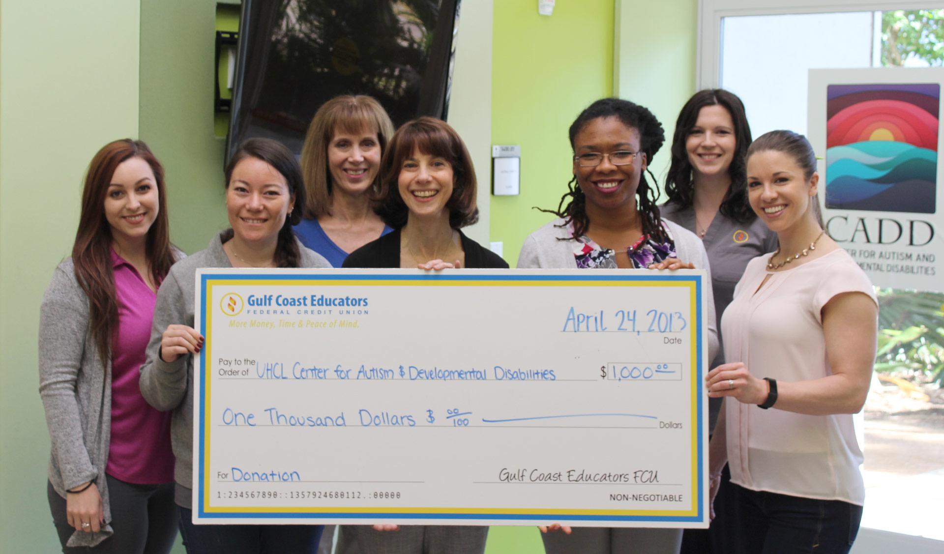 Credit union employees raise money for UHCL's autism center